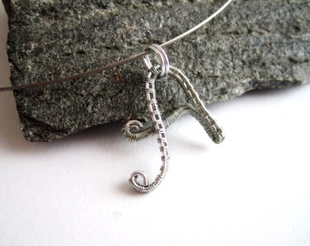 "Letter ""A"" wire wrapping with silver aluminum wire on wire cable ."