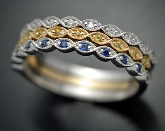One 14kt gold stackable band in gold with sapphires or diamonds