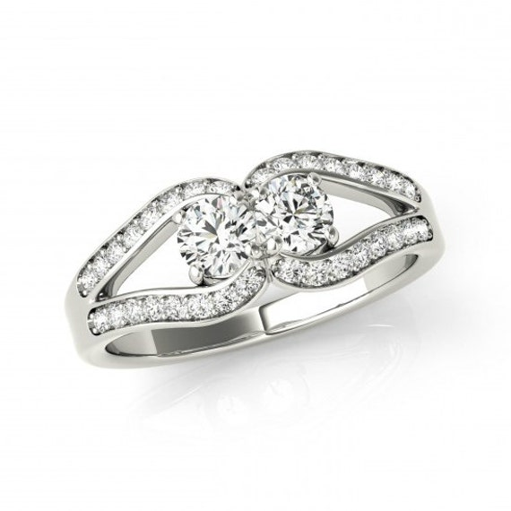 1 carat forever one moissanite love knot by ravenfinejewelers