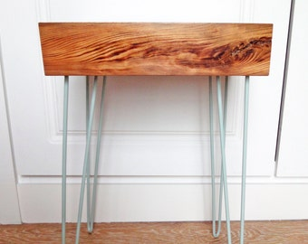 Side table with painted metal legs