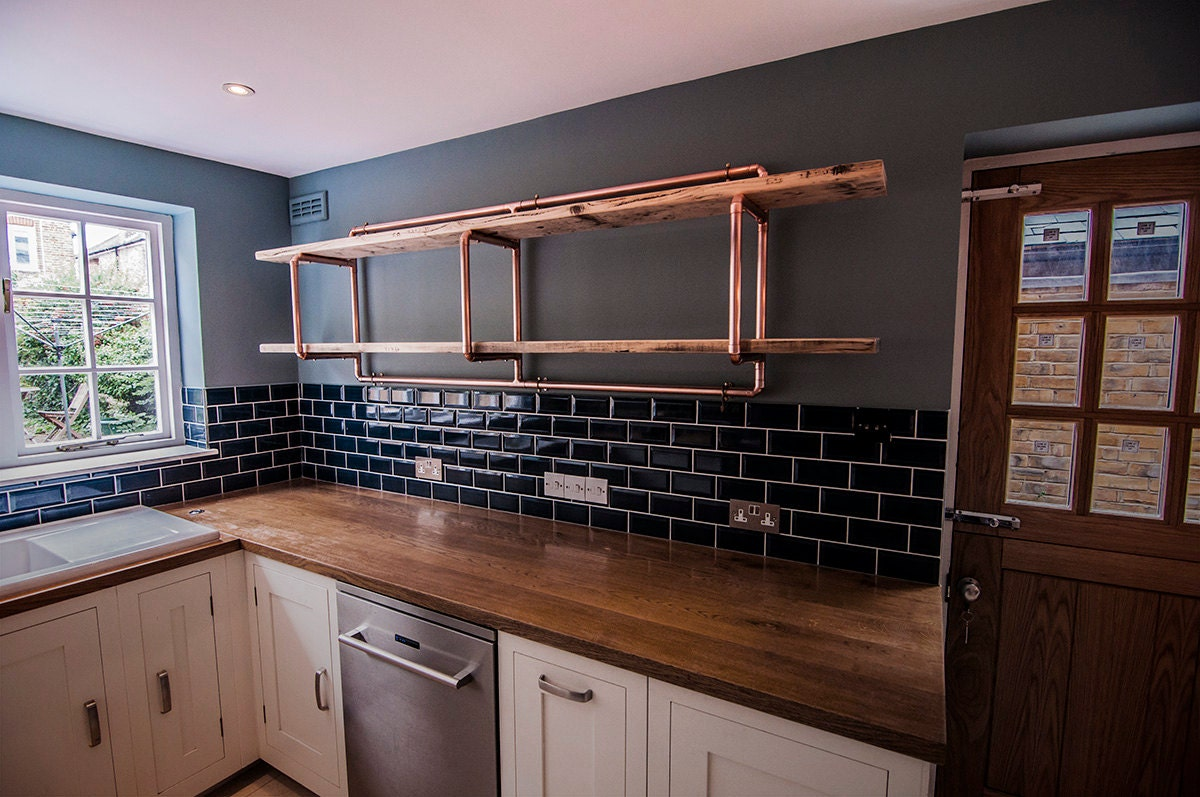 2 shelf copper pipe and reclaimed wood unit wall