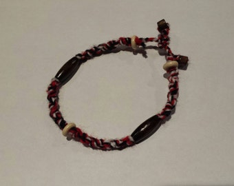 Black, white and red wool bracelet