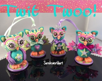 Glow in the dark funky owls, two hanging, two without ribbon.
