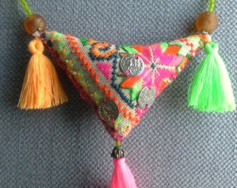 Necklace/pendant textile boho in bright vibrant colours.