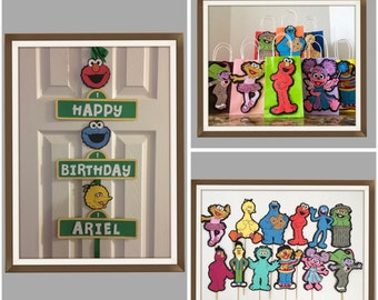 3 sets of sesame street theme birthday. 6 favor bags, 4 centerpieces sticks.and 1 door sign