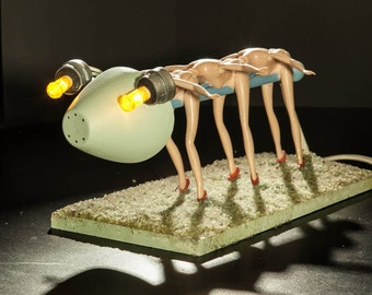 Creature with heels.   Sculpture with light.  Recycled materials.