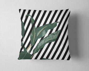 Black and white striped banana leaf throw pillow