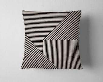 Black and tan geometric striped pillow