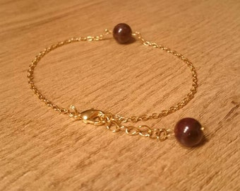 Bracelet made of gilded silver with Garnet