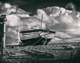 Shady Nook. A fine art photographic Giclée print in the wet plate style of a beached fishing boat at Thorpeness on the Suffolk coast