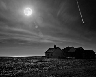 Full Moon over Shingle Street. A dark and eerie  black and white fine art photographic print of the full moon over Shingle Street in Suffolk