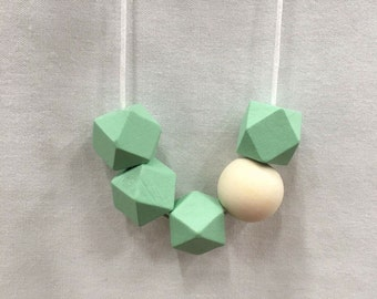 Geometric and round wooden bead necklace // natural and pastel green // hand painted