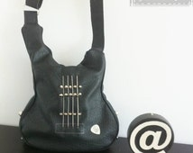 Shaped quitar bag decorated with real strings