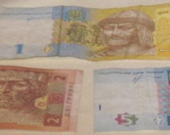 3 modern Ukrainian banknotes money – 1 UAH, 2 UAH, 5 UAH.