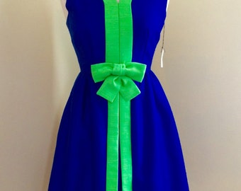 1950's Town & Country hour glass party dress. Never worn with original price tag on it.