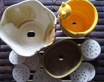 Pot spots - handmade drainage hole covers for plant pots