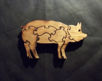 Pig Puzzle handmade out of Hickory