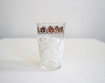 Vintage white and gold drinking glass