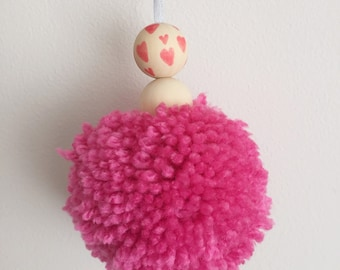 20cm Pompom bead wall hanging in mid pink wool