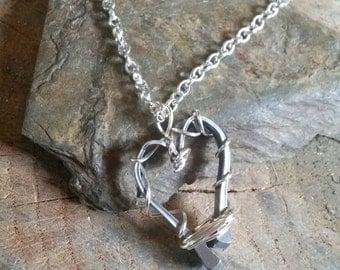 Horseshoe nail heart necklace