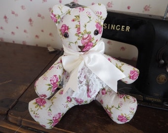 Hand crafted vintage teddy bear in a floral shabby chic fabric.