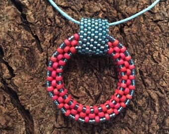 Red/orange and teal donut pendant