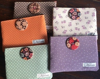 Small clutch bag with button