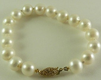 "Freshwater Pearl 8.5 mm - 9.1 mm Bracelet 14k Yellow Gold Fish Locks 7 1/4"""
