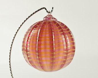 Hand Blown Glass Ornament light redish color with light carmel trim