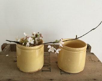 Set of 2 vintage French yellow glazed pots