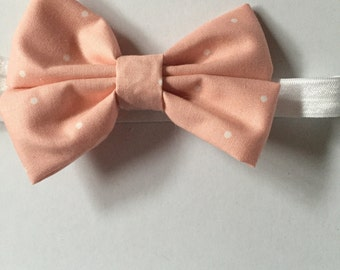 Coral pink and white polka dot hair bow for girls