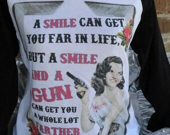 Womens baseball tee, a smile and a gun