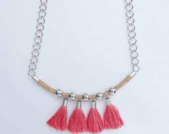 Cork necklace with beads and metal chains and pink cotton fringes, metal terminals.