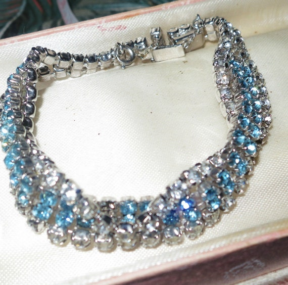 Vintage 1950s signed KRAMER clear and tuquoise rhinestone bracelet with safety chain