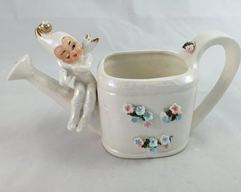 Adorable vintage 1950's Lefton iridescent winking winter pixie watering can with flowers