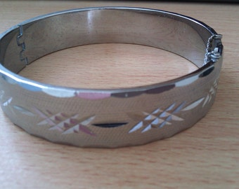 vintage silver coloured bangle