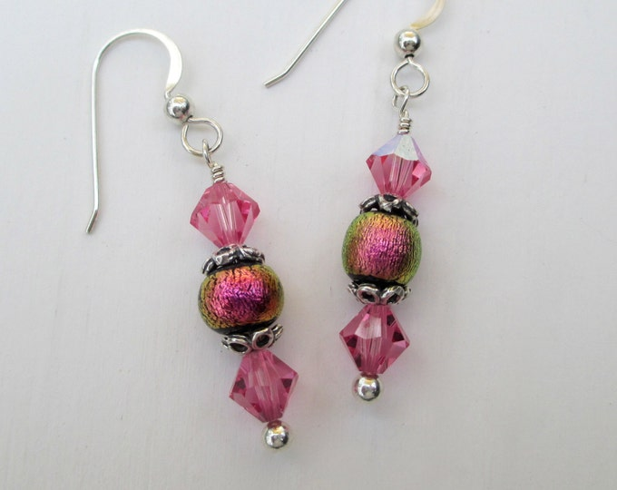handmade pink dichroic glass bead with pink Swarovski crystal on sterling silver ear wires