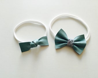 Light blue leather bow