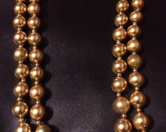 Georgiou double strand gold bead necklace