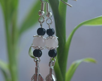 Earrings, semi precious stones, rose quartz and black agate, feather symbol