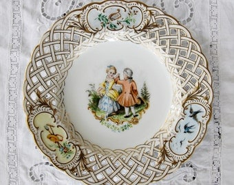 Porcelain Plate,  Victorian couple, reticulated edges,  gilt borders, center cameo of dancing pair, 1920s