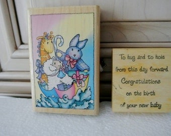 Two wood mounted baby stamps