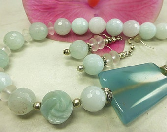 Faceted Amazonite set with agate