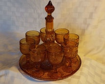 Mid-Century Barware Vintage Amber Pressed Glass Decanter with 8 Glasses and Round Tray Sandwich Pattern
