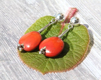Red orange huayruro seed and silver dangle earrings