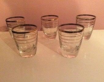 Five vintage 50s gold rimmed/patterned shot/liqueur glasses.