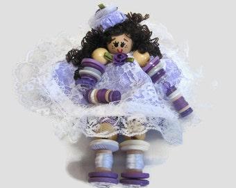 Purple dress button doll