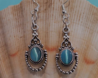 Antique silver charm with aquamarine cats eye earrings