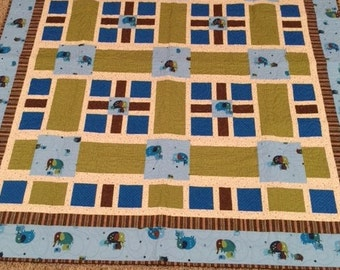 Baby Elephant Quilt.  54 x 59  Blue, green, brown.  Hand pieced, machine quilted.