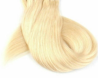 Custom tape in or clip in human hair extensions